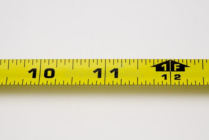 Una cinta de medición foto de archivo
