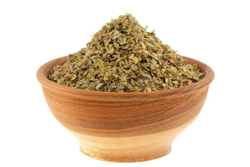 Una ciotola di erba aromatica secca: Origano dolce fotografia stock libera da diritti