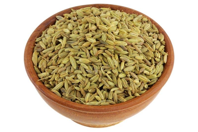 Una ciotola di semi di finocchio secchi fotografia stock