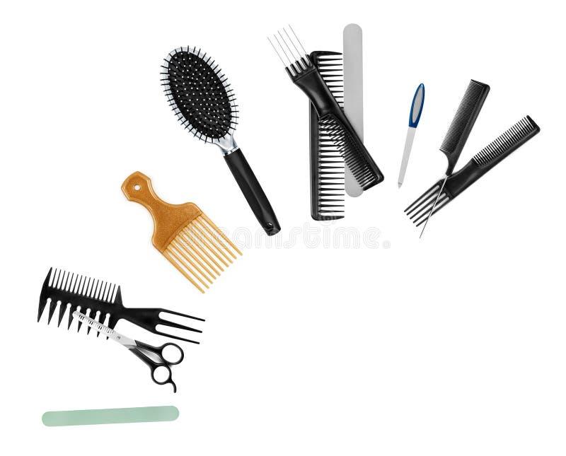 Una collezione di strumenti per lo stilista di capelli professionista fotografie stock libere da diritti