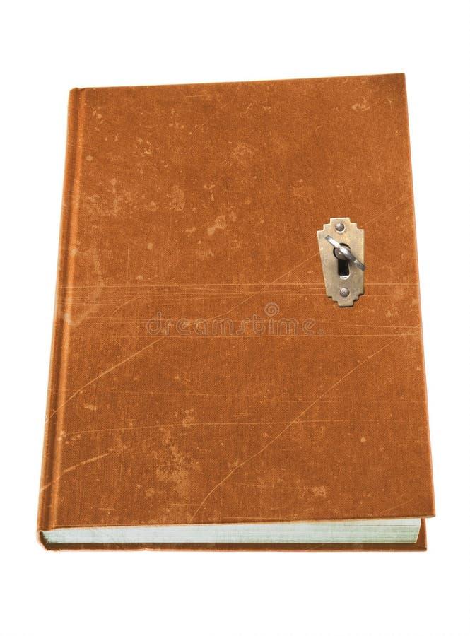 Una combinazione chiave del libro e del serratura e fotografia stock libera da diritti