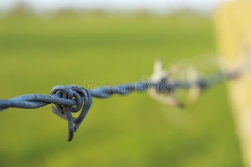 Una corda legata intorno ad una colonna fotografia stock libera da diritti