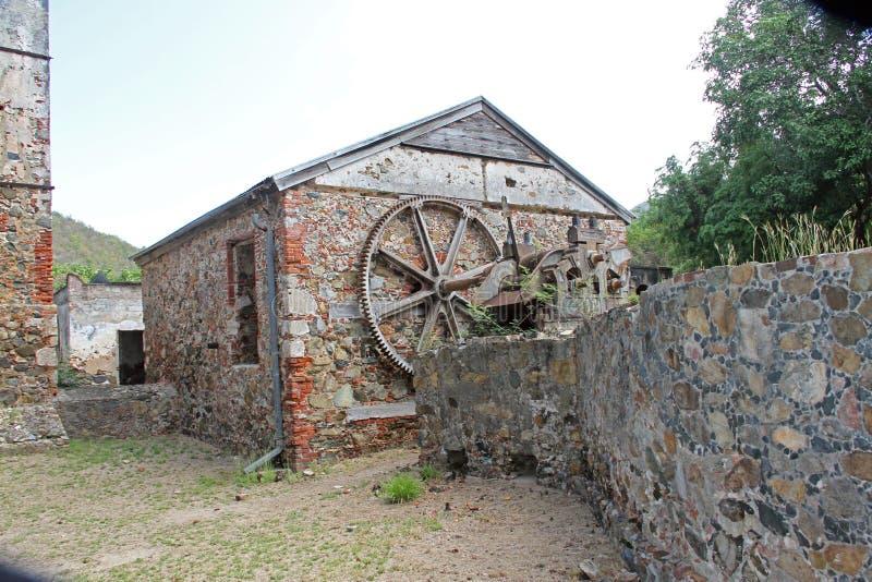 Una costruzione alla baia Sugar Factory della scogliera fotografie stock