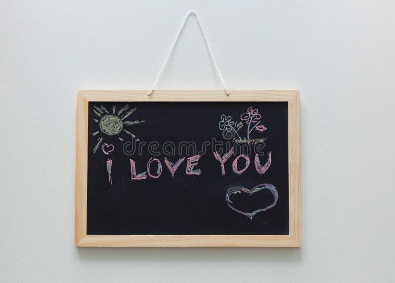 Una dichiarazione di amore scritta su una lavagna fotografie stock