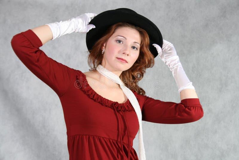 Una donna con un cappello immagini stock