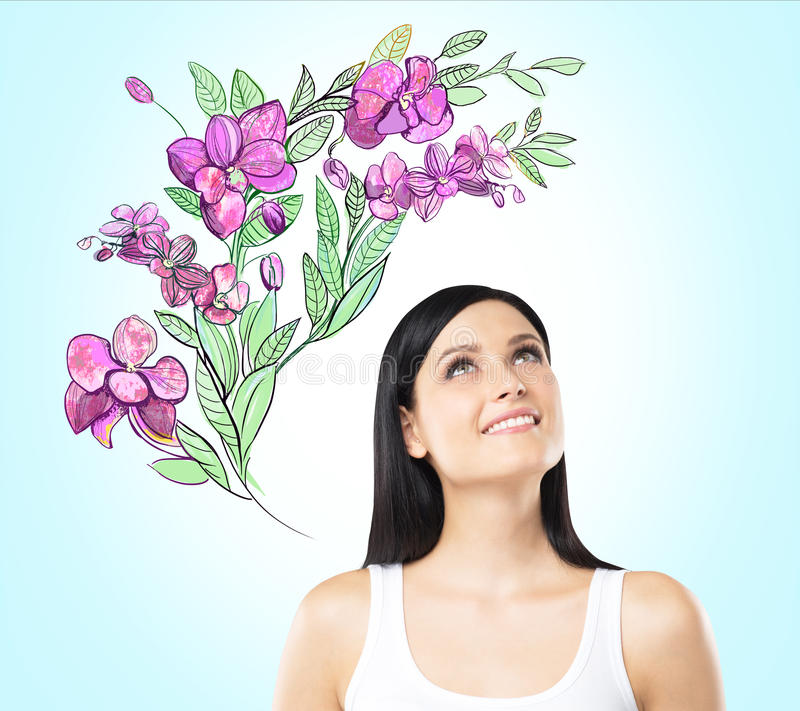 Una donna ispirata sta sognando dei fiori dell'estate illustrazione vettoriale