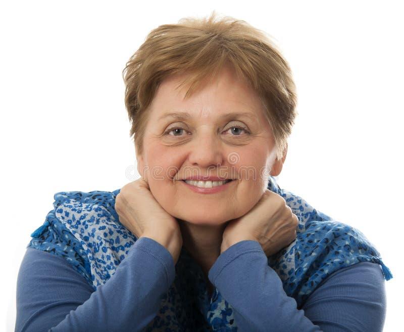Una donna senior felice immagine stock