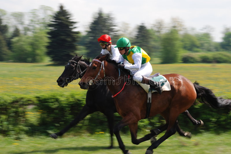 Una escena de una carrera de caballos imagen de archivo