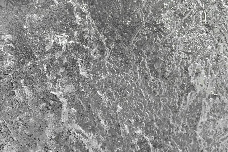 Una estructura y manchas de agua congelada de fragilidad en color blanco y negro. fondo natural abstracto fotografía de archivo libre de regalías