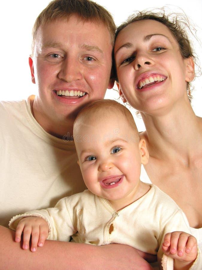 Una famiglia di tre sorridente immagine stock libera da diritti