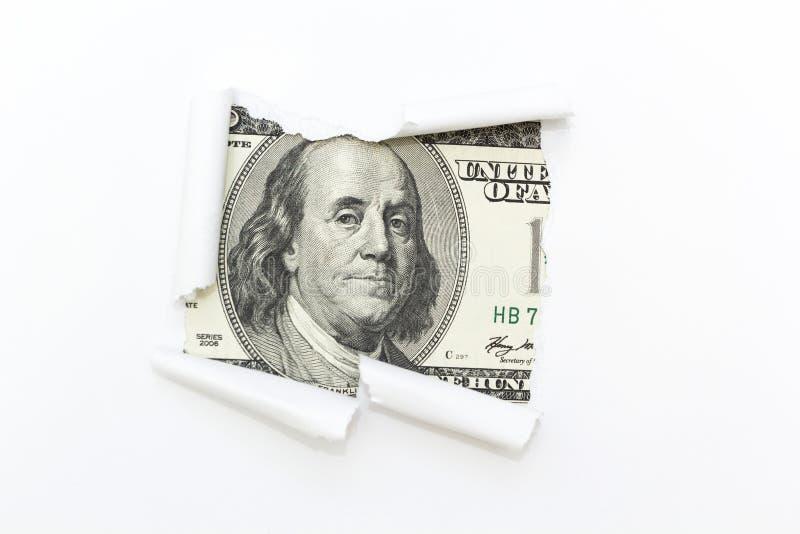 Una fattura del cento-dollaro in una rottura bianca del fondo Un foro in un fondo bianco Soldi nascosti, evasione fiscale Corruzi fotografia stock libera da diritti