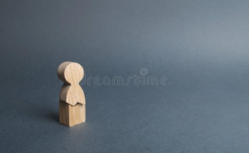 Una figura de madera de un hombre con una grieta concepto de tensión psicológica y de presión No pod?a colocar los nervios y nues fotos de archivo