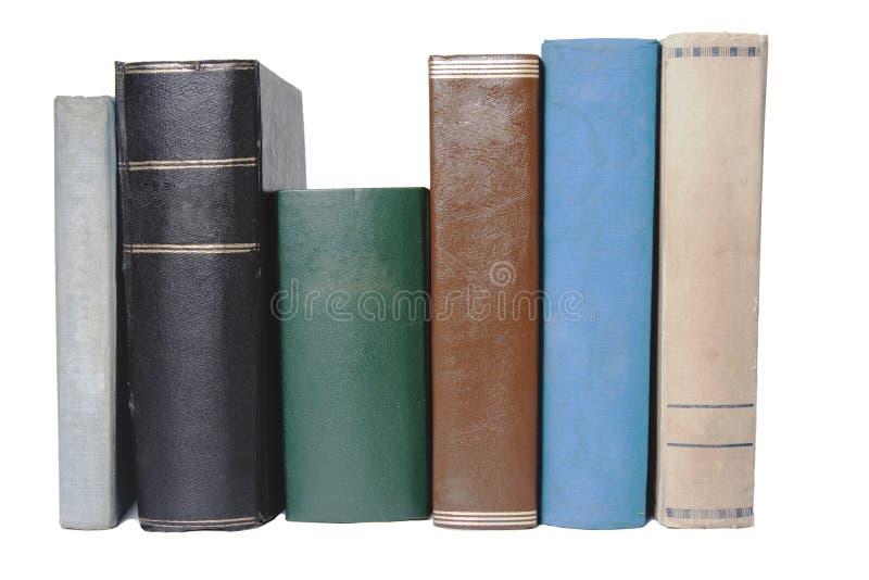 Una fila de libros viejos coloridos foto de archivo