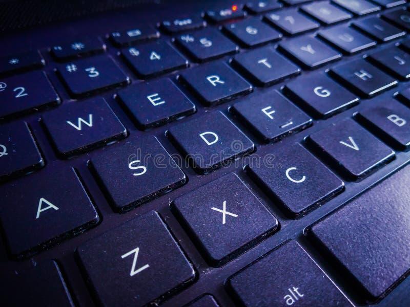 Una fine su della tastiera del computer portatile immagine stock libera da diritti