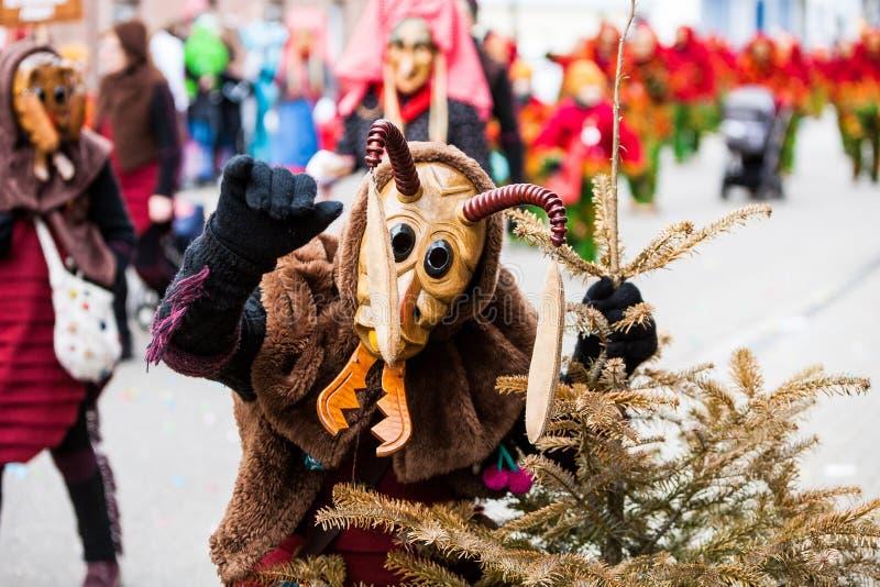 Una formica dal festival di travestimento ha chiamato Narrenumzug È un carnevale in Germania del sud nel periodo di celebrazione  fotografie stock