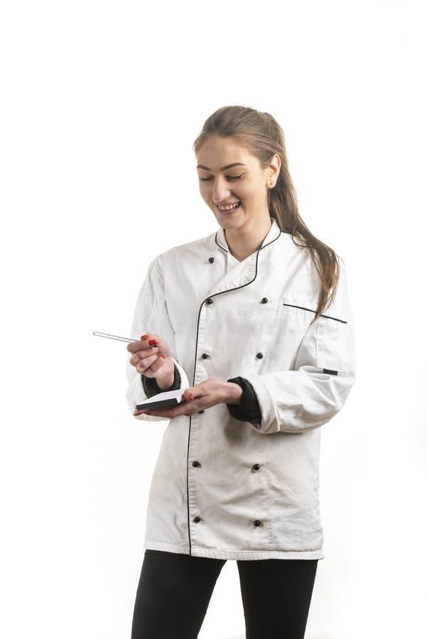 Una giovane cameriera di bar che accetta l'ordine fotografie stock libere da diritti