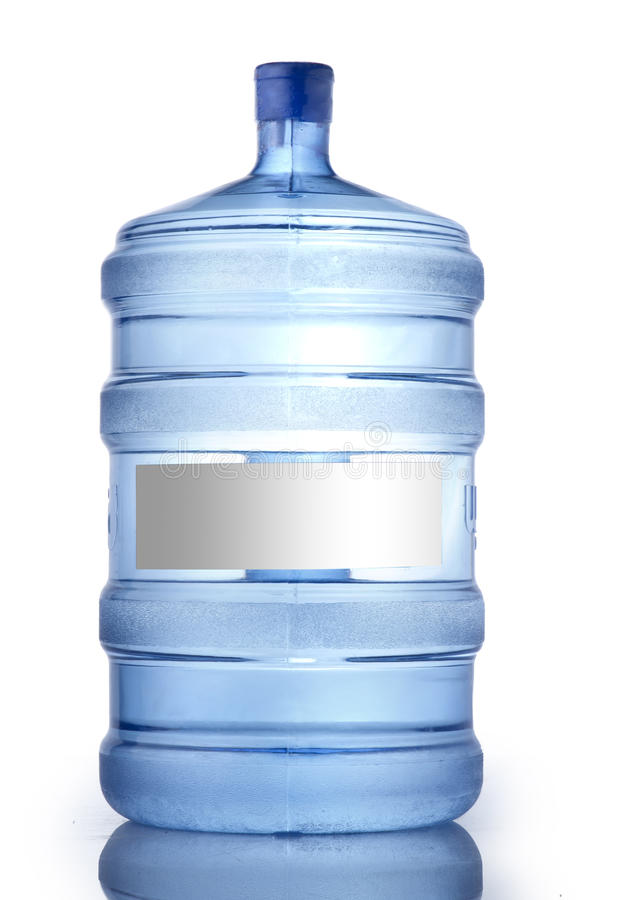 Una grande bottiglia di acqua pura su una priorità bassa bianca fotografia stock libera da diritti