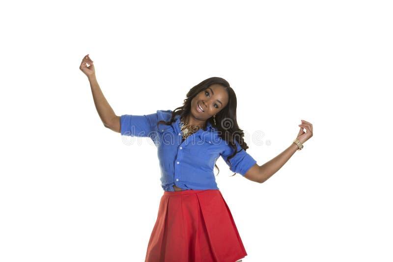 Download Una Hembra Atractiva Aislada Llevando Una Falda Foto de archivo - Imagen de manos, alegre: 44851176