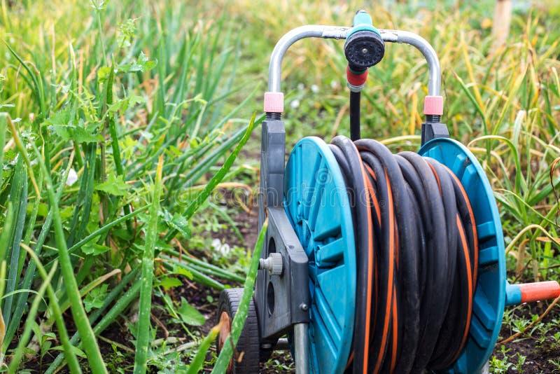 Una imagen de una manguera de jardín Manguera para la irrigación foto de archivo libre de regalías