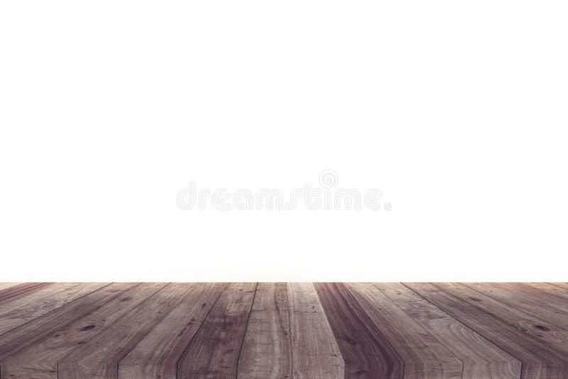 Una imagen de un escritorio de madera delante de un fondo abstracto del blanco fotos de archivo