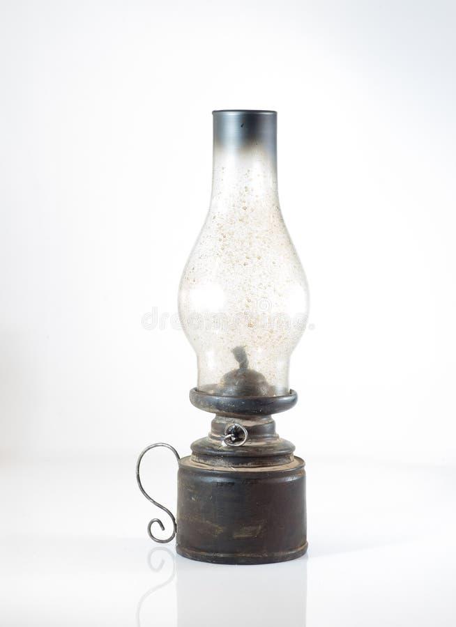 una lámpara de aceite sobre un fondo blanco foto de archivo libre de regalías