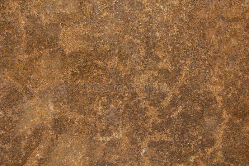Una lamiera sottile arrugginita arancio marrone Struttura della superficie ruvida immagini stock