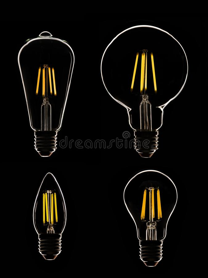Una lampada di quattro LED sul nero immagini stock