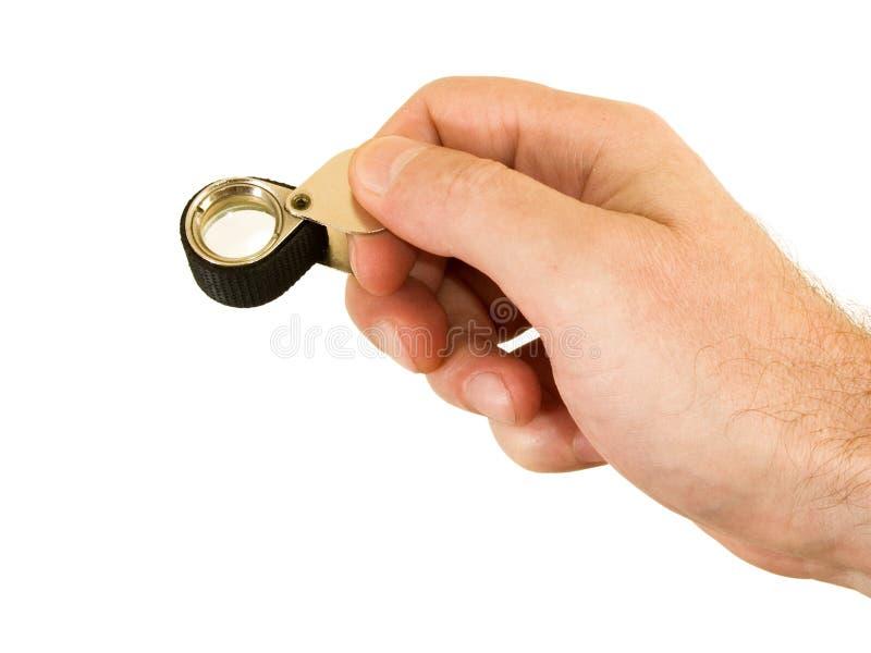 Una lente d'ingrandimento per i gioiellieri immagine stock