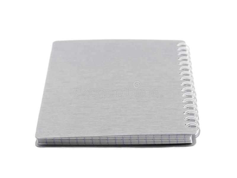 Una libreta con color espiral del gris del soporte Aislado en blanco foreground imágenes de archivo libres de regalías