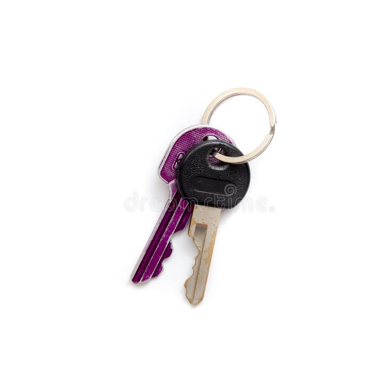 Una llave púrpura y de plata que miente en un blanco aislado imagen de archivo