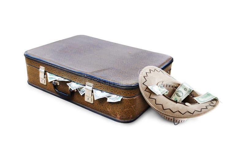 Una maleta por completo del dinero y de un sombrero con limosnas imagen de archivo libre de regalías