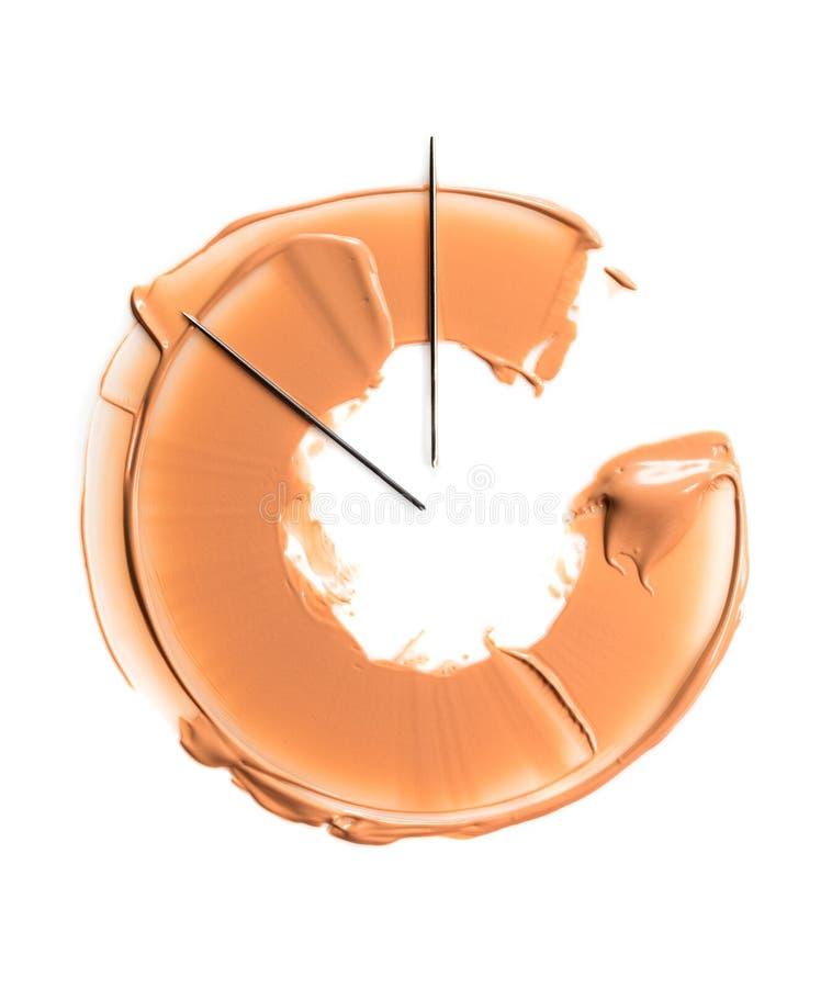 Una mancha de la fundación bajo la forma de semicírculo, simbolizando el reloj El concepto de base tonal de la persistencia duran fotos de archivo