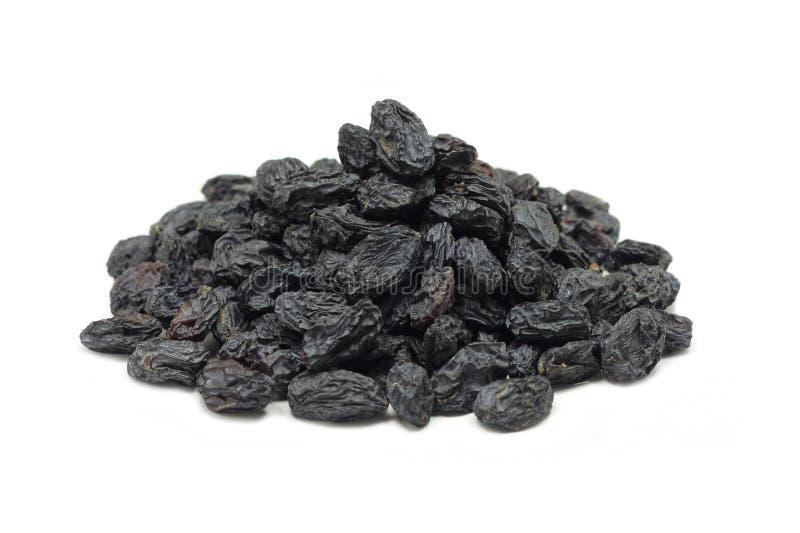 Una manciata di piccola uva passa nera immagini stock