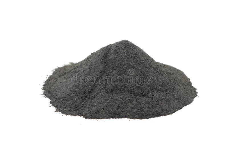 Una manciata di polvere nera della polvere fotografie stock