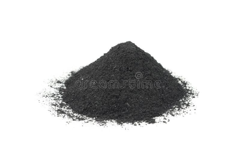 Una manciata di polvere nera nera fotografia stock
