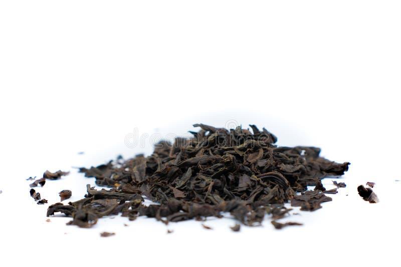 Una manciata di tè nero immagini stock libere da diritti