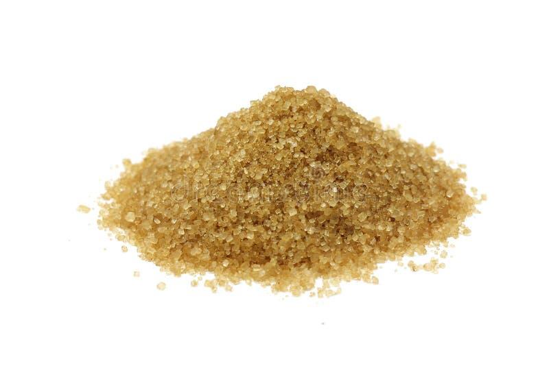 Una manciata di zucchero di canna marrone fotografie stock libere da diritti
