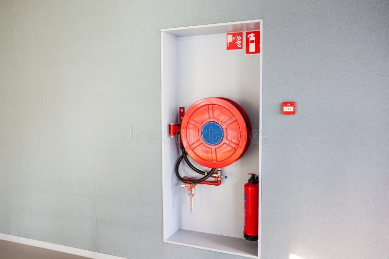 Una manguera de bomberos imágenes de archivo libres de regalías