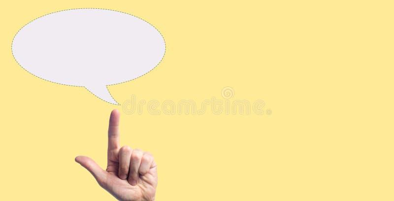 Una mano che indica l'icona in bianco della bolla il concetto sogna, concetto che pensa il nuovo spazio della copia di idea Posto immagini stock