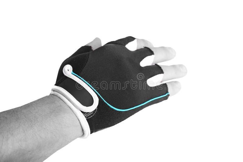 Una mano con el guante de la bicicleta que muestra la mano abierta en el fondo blanco imagen de archivo libre de regalías