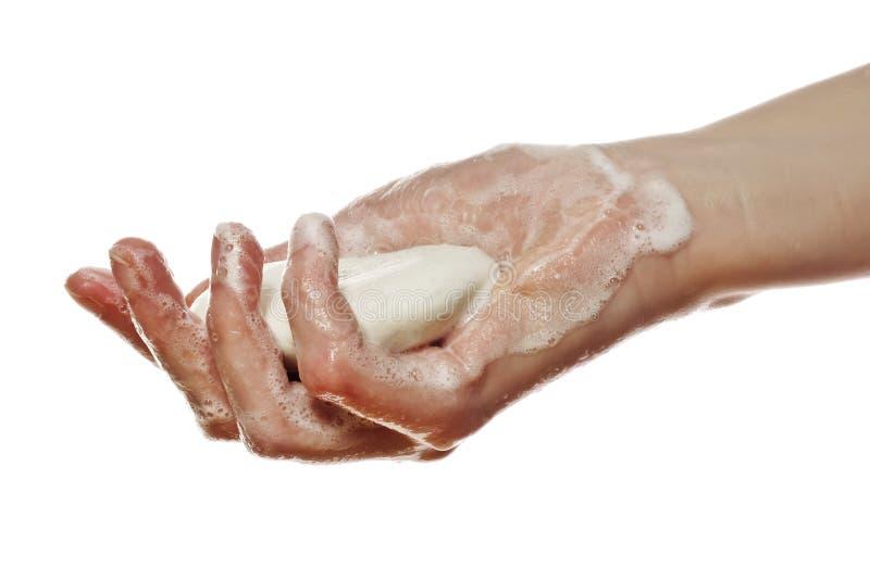 Una mano con el jabón foto de archivo libre de regalías