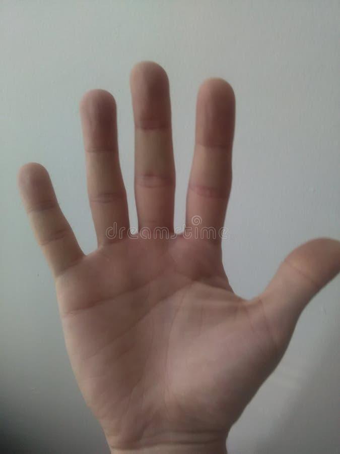 Una mano a decir hola imagenes de archivo