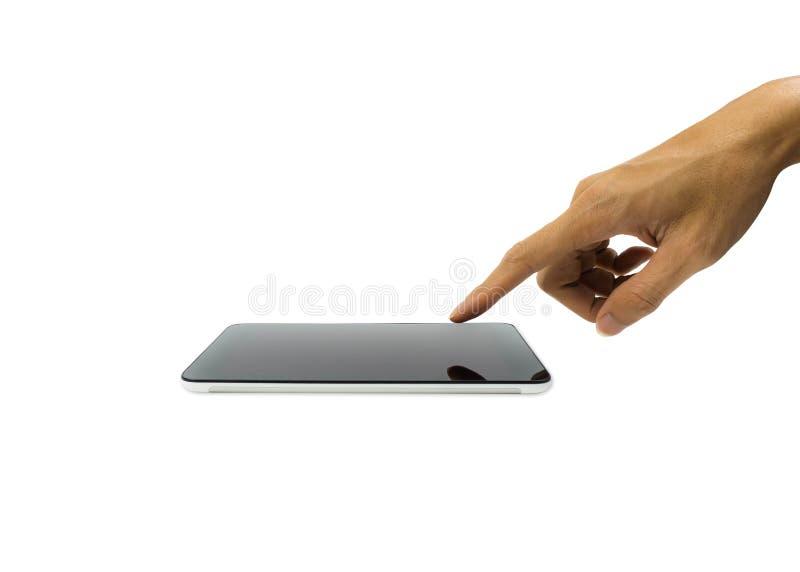 Una mano del hombre que toca en la pantalla horizontal del smartphone o de la tableta aislada en el fondo blanco foto de archivo libre de regalías