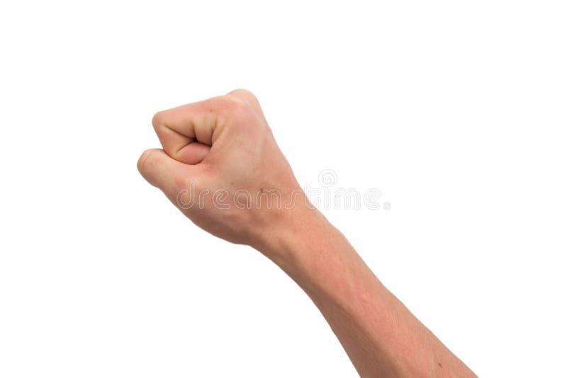 Una mano masculina en un puño imagenes de archivo