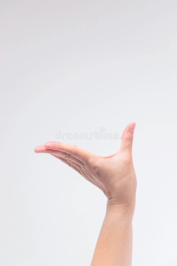 Una mano posturing como la elevación algo no pesado a ser más alta para la presentación fotografía de archivo