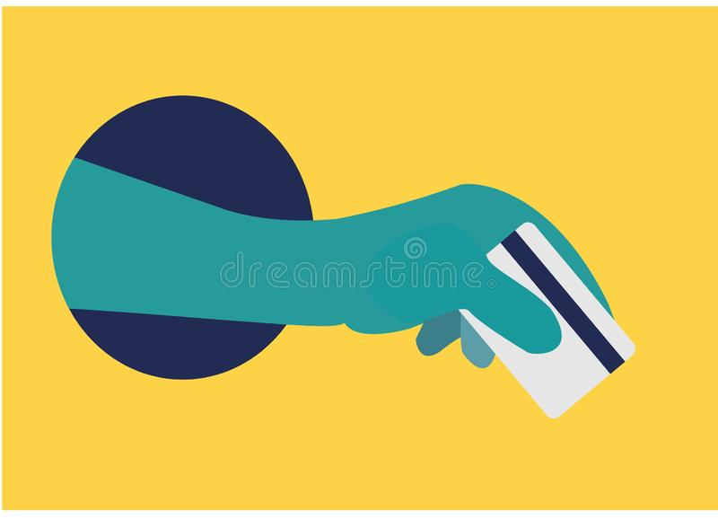 Una mano sostiene una tarjeta de banco de crédito de un agujero en una pared amarilla El concepto de compras en l?nea Scammers de libre illustration