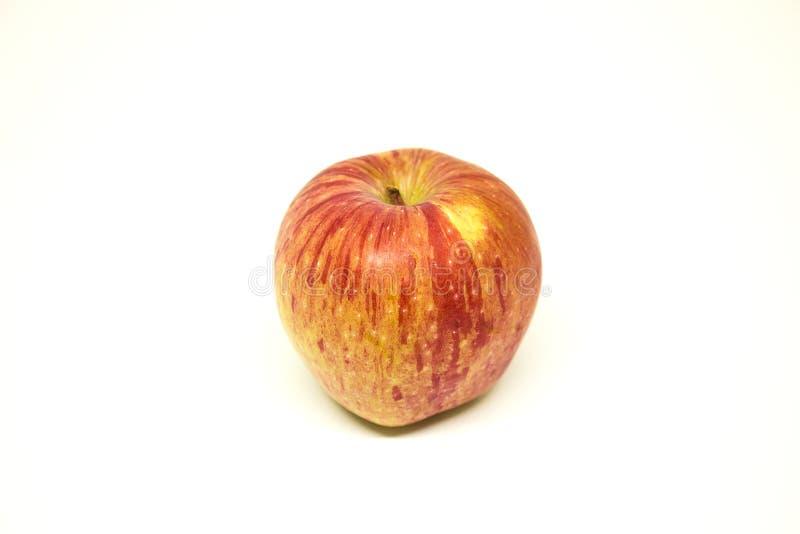 Una manzana en el fondo blanco imagen de archivo libre de regalías