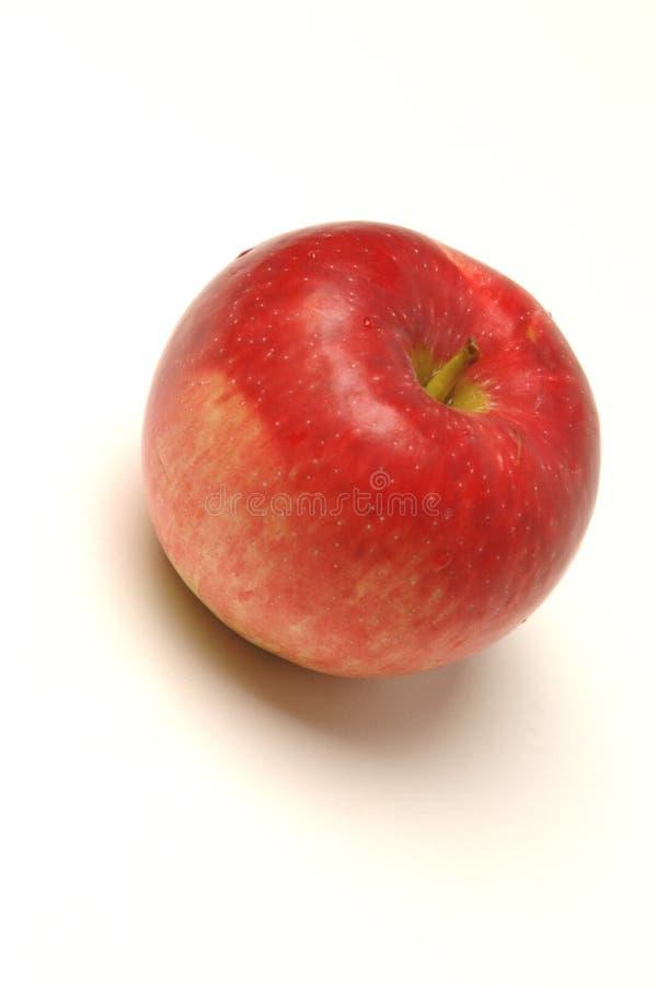 Una manzana roja foto de archivo