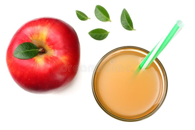 una manzana roja con el zumo de manzana aislado en el fondo blanco Visión superior fotos de archivo libres de regalías