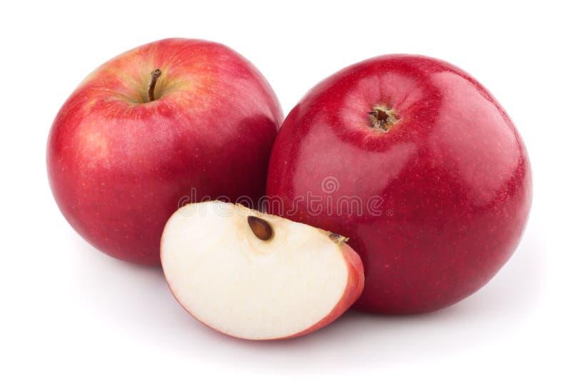 Una mela e una fetta di due colori rossi immagini stock